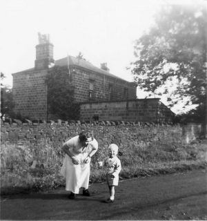 Dorothy Bitton With Son Mike With The Farm Residence Behind, Circa 1954