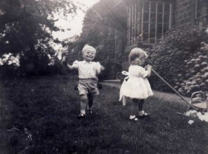 Mike Bitton Grandson Of George Bitton Farm Bailiff 1931 - 1954 Playing In The Garden Of Holme Farm With Storeman Murphy's Daughter circa 1954