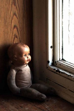 An Asylum Doll in The Window
