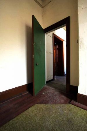 Asylum Room with Green Door