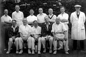 Menston Cricket Team 1949 - 1950, 3rd from right on the back row George Kell - butcher at High Royds, 2nd left front row - Norman Hancock - Chief Male Nurse